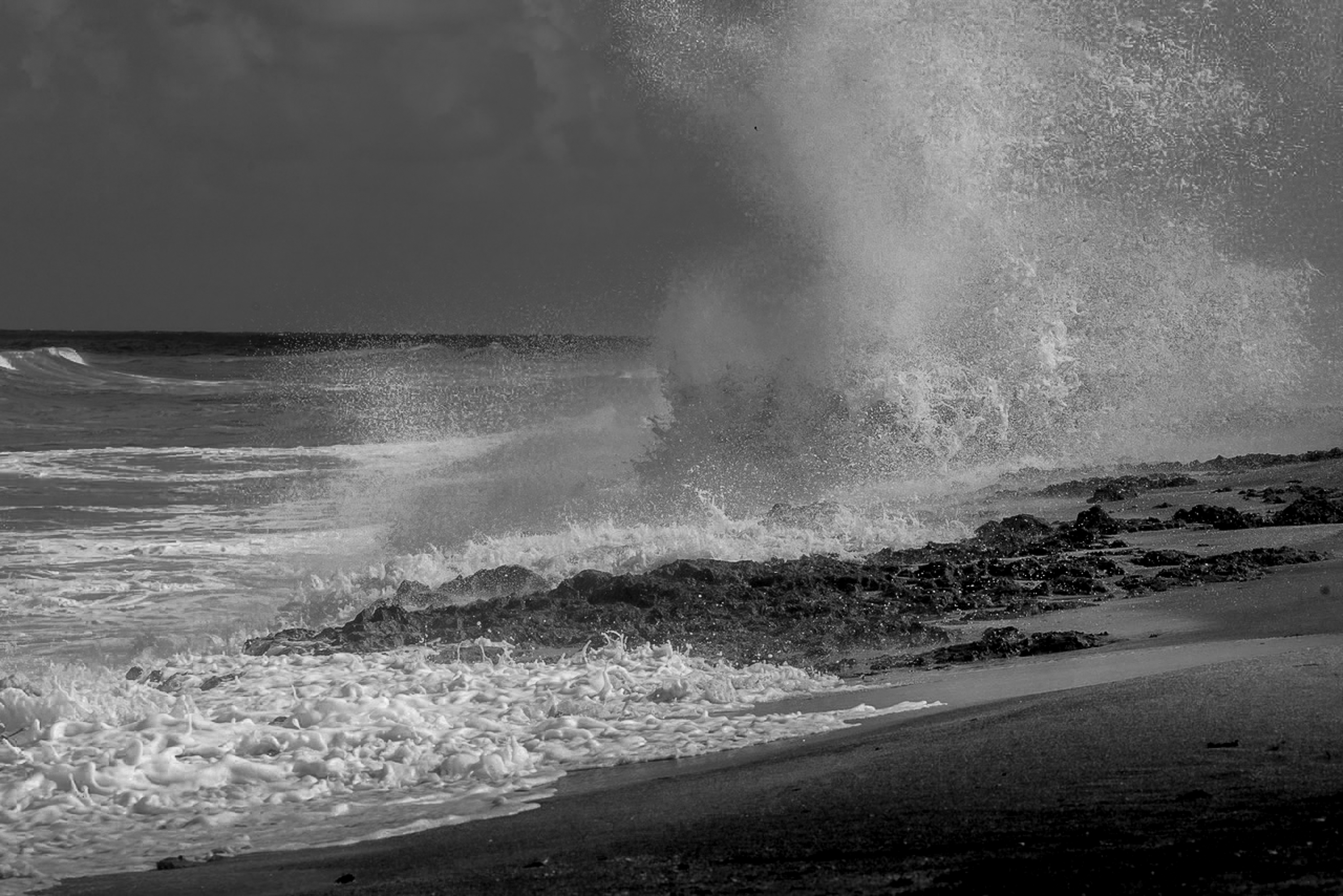 Blowing Rocks Jupiter Beach A plume of ocean water created by breaking waves